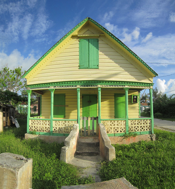 yellow house green trim is this a traditional bahamian