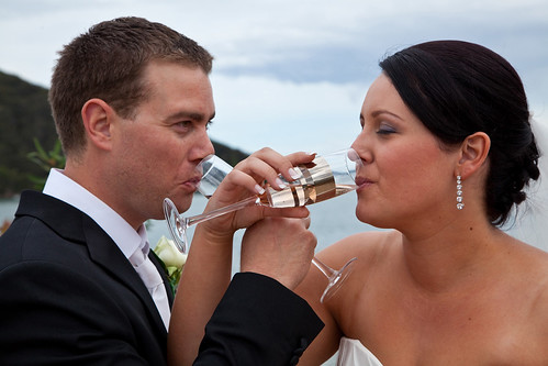Artistique Photography by Nicolette - bride and groom having champagne.