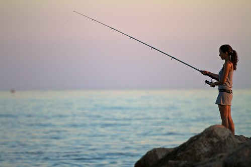 Spanish Girl Fishing at Sunset