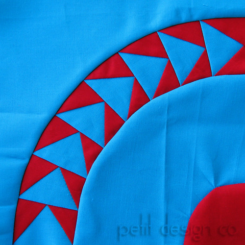Red and Teal flying Geese