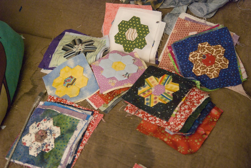 An odd little project I've been picking away at in my spare time - English paper-piecing these little hexagon flowers, and then using fusible web to put them on fabric squares.  (Hexagons are 0.5' on a side.)