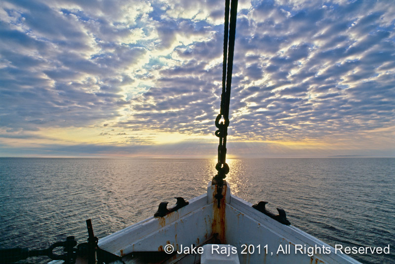 Bow of fishing boat at dawn long island sound new york for Long island sound fishing