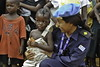 An UN Peace-keeper chats with a child during the Peacekeeper's  day celebration which paid tribute to UN peacekeepers in Liberia who made the ultimate sacrifice in the service of peace in Liberia. The ceremony was held on May, 27, 2011 in Monrovia and bro