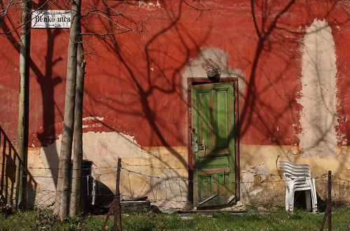 life street door old city shadow urban detail building tree green art sign wall architecture fence photography 50mm daylight wooden still wire chair mural scenery closed hungary mood branch exterior outdoor budapest atmosphere nobody scene architectural plastic explore environment series weathered visual exploration streetname ruined frontview fragment bough reddish streetplate bole milieu wallscape patinated sonofsteppe pusztafia zugló streetplatesofbudapest urbanlifeoftrees alsórákos benkőutca