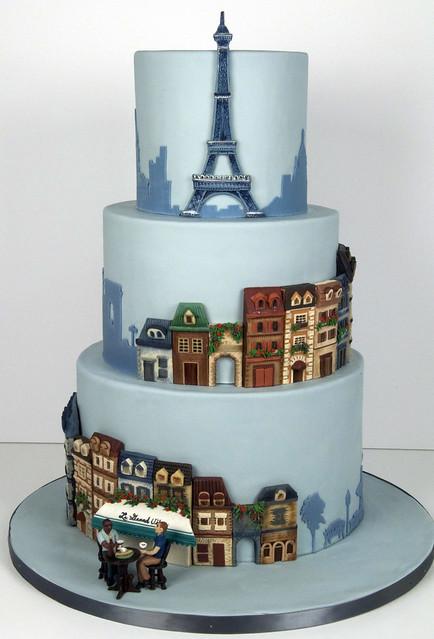 A Parisian Theme wedding cake with the Eiffel Tower and quaint Paris street