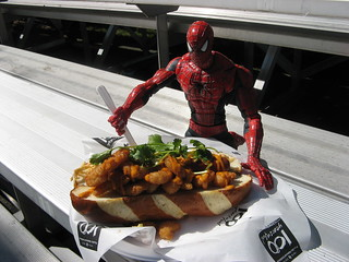 Spider-Man eats an over-priced hotdog at the PNE