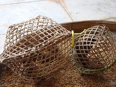 agriculture(0.0), straw(0.0), wicker(0.0), food(0.0), iron(0.0), cage(1.0), basket(1.0),