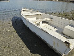 ship(0.0), lcvp(0.0), watercraft rowing(0.0), mast(0.0), dock(0.0), dinghy(1.0), vehicle(1.0), skiff(1.0), watercraft(1.0), boat(1.0), waterway(1.0),