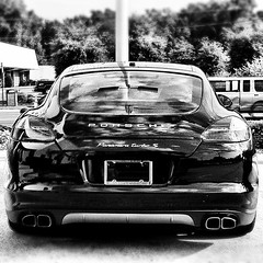 executive car(0.0), wheel(0.0), aston martin dbs(0.0), automobile(1.0), automotive exterior(1.0), vehicle(1.0), performance car(1.0), automotive design(1.0), porsche(1.0), porsche panamera(1.0), monochrome photography(1.0), bumper(1.0), land vehicle(1.0), monochrome(1.0), luxury vehicle(1.0), black-and-white(1.0), supercar(1.0), sports car(1.0),