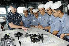 In this file photo, USS Blue Ridge (LCC 19) navigator, Lt. Joshua Virgadamo, shows Republic of Korea sailors different methods to plot the ship's course during a tour of the ship Aug. 19. (U.S. Navy photo by Mass Communication Specialist 2nd Class Josh Curtis)