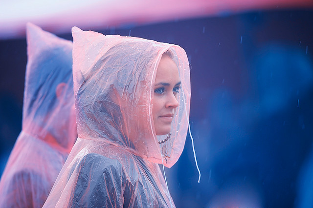 Girl in the rain staring