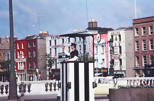 Garda directing traffic, O'Connell Bridge, Dublin