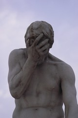 statue in facepalm pose