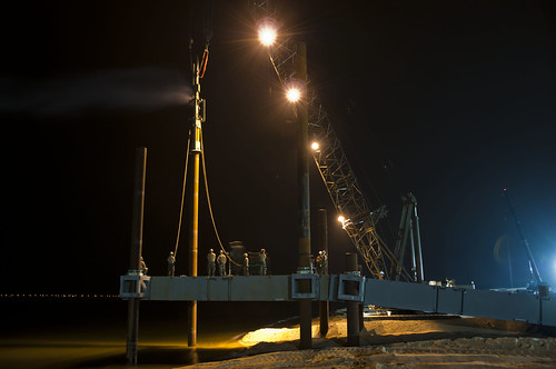 Seabees work the late shift to drive piles