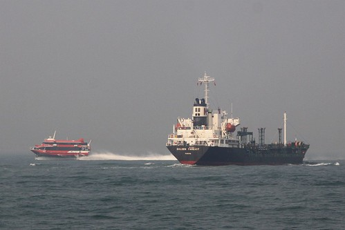 TurboJet hydrofoil cuts across the bow of tanker 'Golden Fareast' off Hong Kong Island