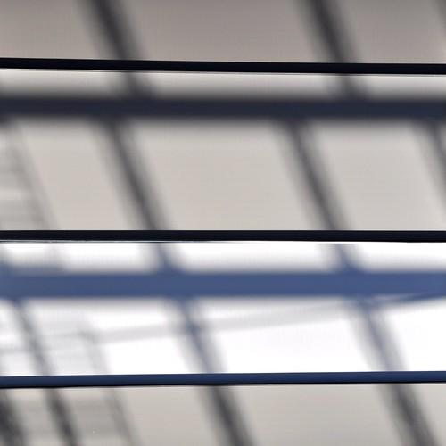blue light glass facade dark outside afternoon shadows exterior contemporary steffentuck hasselarchitects