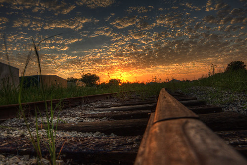 sunset building clouds yard train amber rust near decay steel rail storage far f28 gravel 14mm samyang