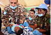 UN photo/ Emmanuel Tobey, Monrovia, Liberia:.UNMIL  Joint Military Medical Outreach Team treats a child in West Point Township during the Day of the African Child (DAC) program held in Monrovia..