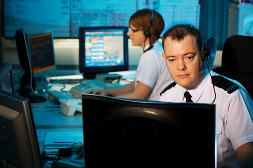 Police officers at work in the West Midlands Police (UK) Contact Centre.