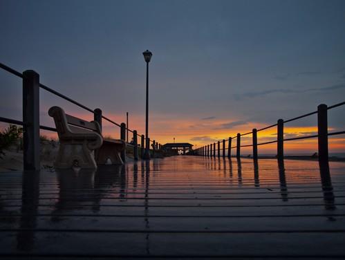 sunset sea color beach rain weather clouds sunrise shore boardwalk railing
