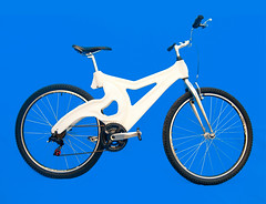 bmx bike(0.0), freestyle bmx(0.0), cyclo-cross bicycle(0.0), bmx racing(0.0), bicycle racing(1.0), mountain bike(1.0), road bicycle(1.0), wheel(1.0), vehicle(1.0), sports equipment(1.0), hybrid bicycle(1.0), cycle sport(1.0), racing bicycle(1.0), land vehicle(1.0), bicycle wheel(1.0), bicycle frame(1.0), bicycle(1.0),