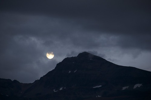 Full moon rising over the mountain