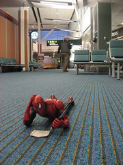 Spider-Man doing sudoku on the floor at YVR