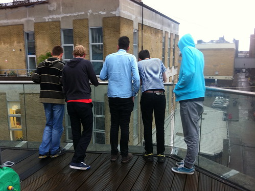 Some designers on a roof