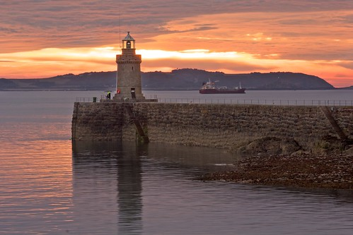 lighthouse sunrise harbour guernsey