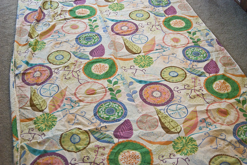 This is Valori Wells' fabric 'Ingrid' in the 'gypsy' colorway. The fabric is huge -- close to 52' wide? -- and the blooms and circles are huge! I loved it online, but it's better in person.