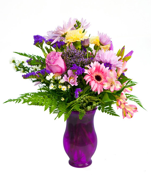 This is a beautiful purple wedding centerpiece of wholesale wedding flowers