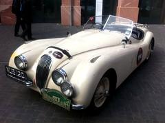 race car, automobile, jaguar xk120, jaguar xk140, vehicle, automotive design, classic car, vintage car, land vehicle, supercar,