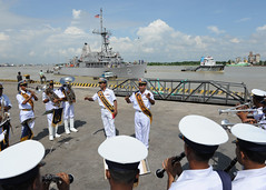 CHITTAGONG, Bangladesh (Sept. 18, 2011) The Bangladesh Navy Band performs on the pier as USS Defender (MCM 2) maneuvers to arrive in Chittagong for exercise Cooperation Afloat Readiness and Training (CARAT) Bangladesh 2011. (U.S. Navy photo by Mass Communication Specialist 1st Class (SW) Lowell Whitman)