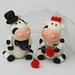 Bride and groom friesian cow wedding cake topper