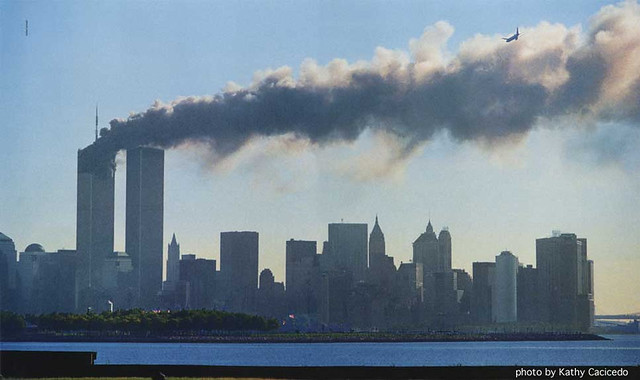 Hijacked jet approaches South Tower of World Trade Center, by Kathy Cacicedo