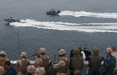 PACIFIC OCEAN (Aug. 14, 2011) Sailors and Marines aboard the San Antonio-class amphibious transport dock ship USS New Orleans (LPD 18) observe Sailors operating rigid-hull inflatable boats with Marines from the 11th Marine Expeditionary Unit (11th MEU) Maritime Raid Force during a practice raid. (U.S. Navy photo by Mass Communication Specialist 3rd Class Dominique Pineiro)