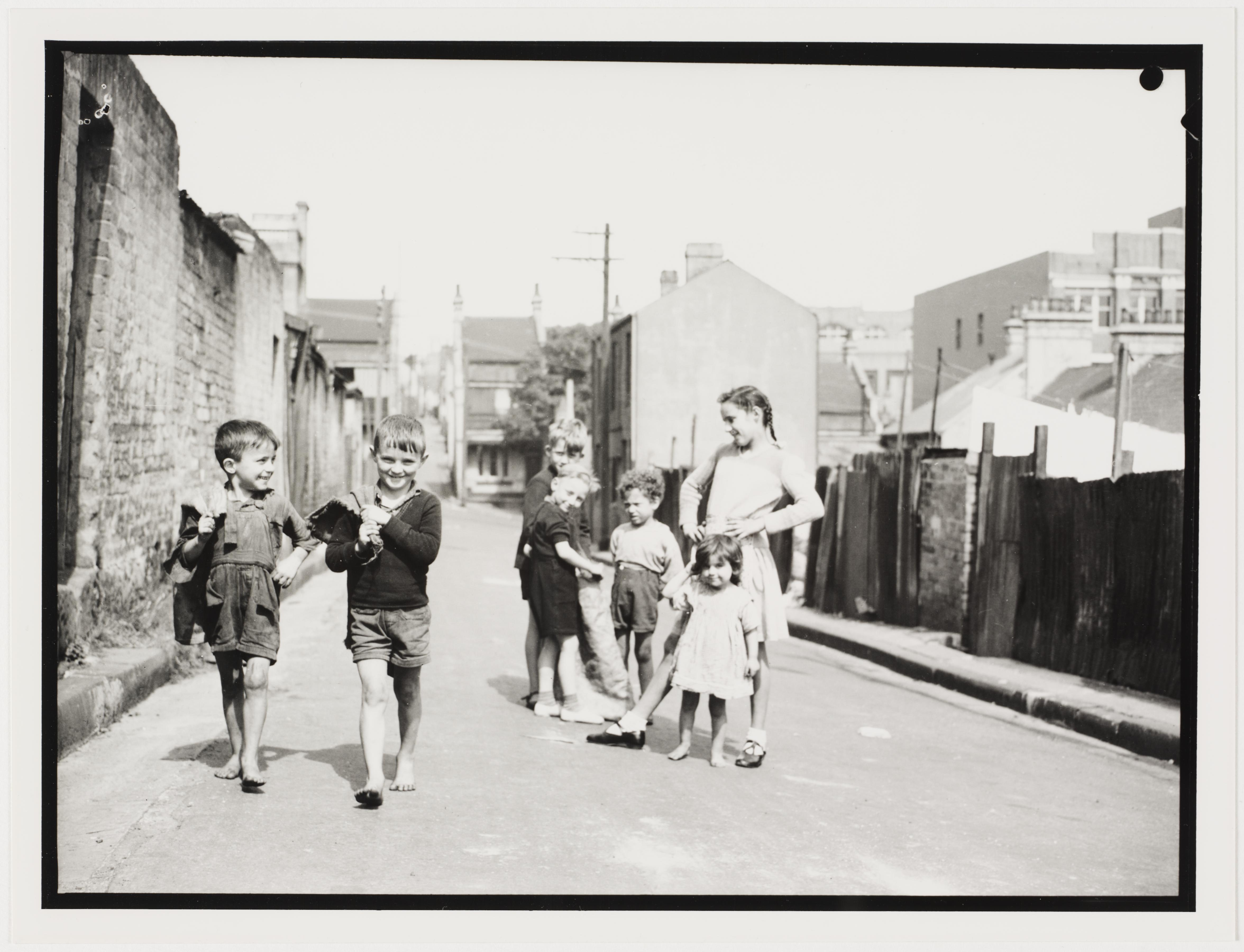 Children in Sydney slums, mainly Surry Hills, Woolloomooloo, Redfern, 1949 by Ted Hood