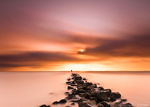 longexposure orange lighthouse clouds sunrise maryland seawall buoys chesapeakebay youvegottohideyourloveaway sandypointstatepark buoyant bwnd110