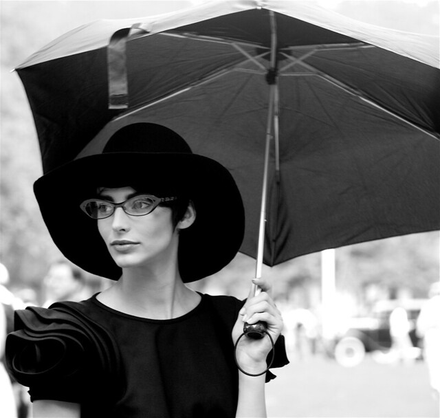 new york city governors island jazz age woman in black dress with umbrella white background