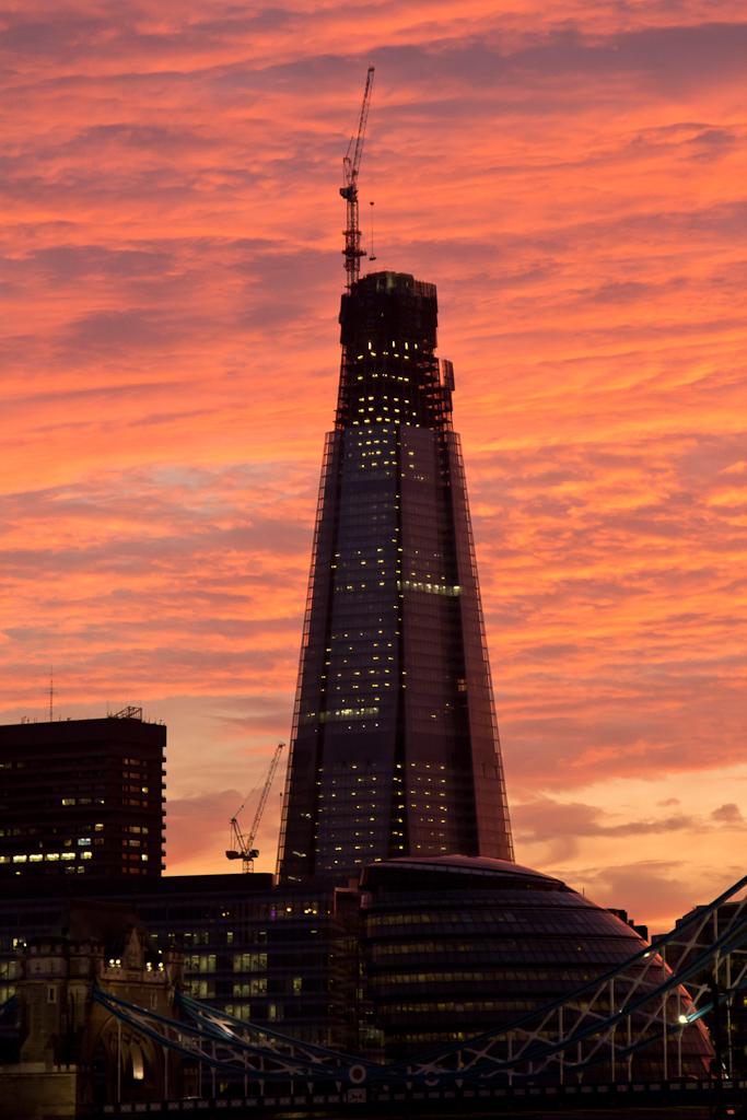 Pink and orange sunset behind The London Shard