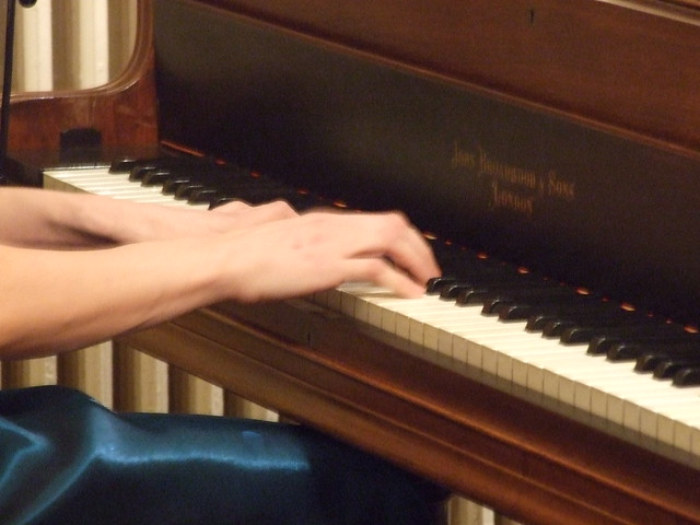 Hands on a grand piano