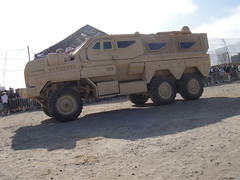 truck(0.0), construction equipment(0.0), armored car(1.0), army(1.0), military vehicle(1.0), vehicle(1.0), off-roading(1.0), armored car(1.0), military(1.0),