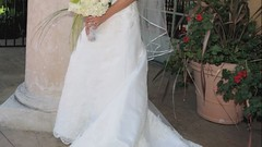 flower arranging(0.0), quinceaã±era(0.0), bride(1.0), veil(1.0), bridal clothing(1.0), bridal veil(1.0), flower(1.0), gown(1.0), clothing(1.0), wedding(1.0), floral design(1.0), floristry(1.0), wedding dress(1.0), dress(1.0), ceremony(1.0),