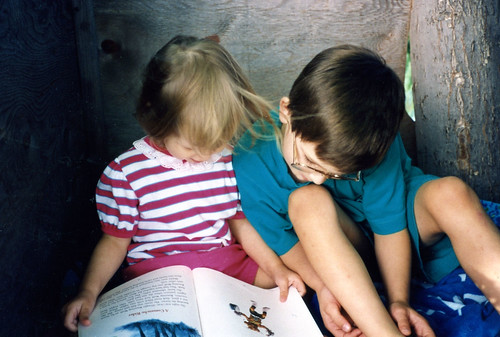Christina (2) and Will (7) reading outdoors, 1992.