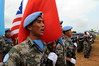 Photo: Emmanuel Tobey/UNMIL, Zwedru, Grand Gedeh County, Liberia: UNMIL Chinese Contingent serving with the UN Mission in Liberia presents arms at a medal parade held in their honor.
