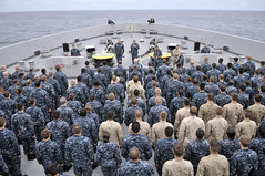 In this file photo, Cmdr. Kevin Meyers, commanding officer of the amphibious transport dock ship USS Green Bay (LPD 20), addresses Sailors and Marines during an all-hands call in the Indian Ocean Aug. 18. (U.S. Navy photo by Mass Communication Specialist 3rd Class Stephen M. Votaw)