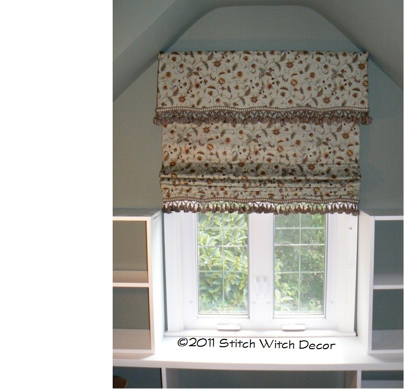 Soft Cornice and Partially open Roman Shade