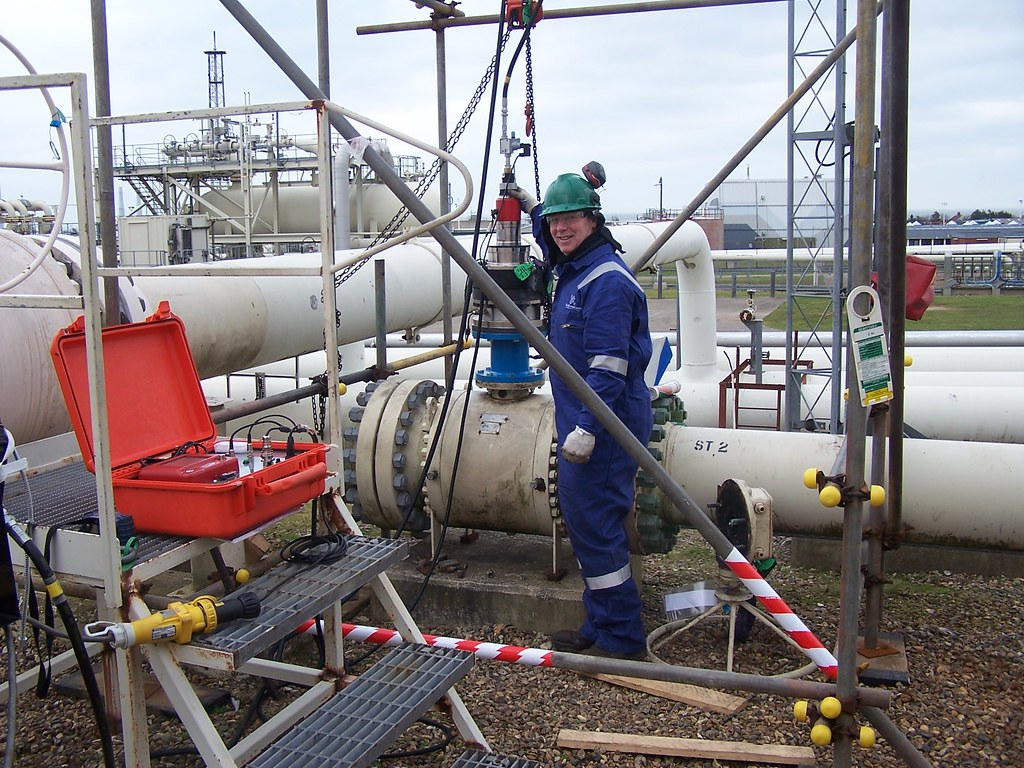 OffShore engineer at the pipeline setting up the system | Flickr