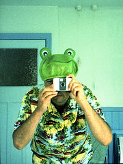 reflected self-portrait with Ricoh Auto-Half camera and frog shower cap