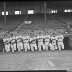 Opening day line up for Boston Braves in dugout at Braves Field
